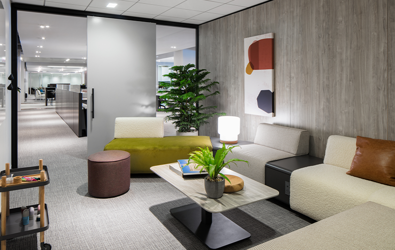 View of lounge with modular sofas and sliding door