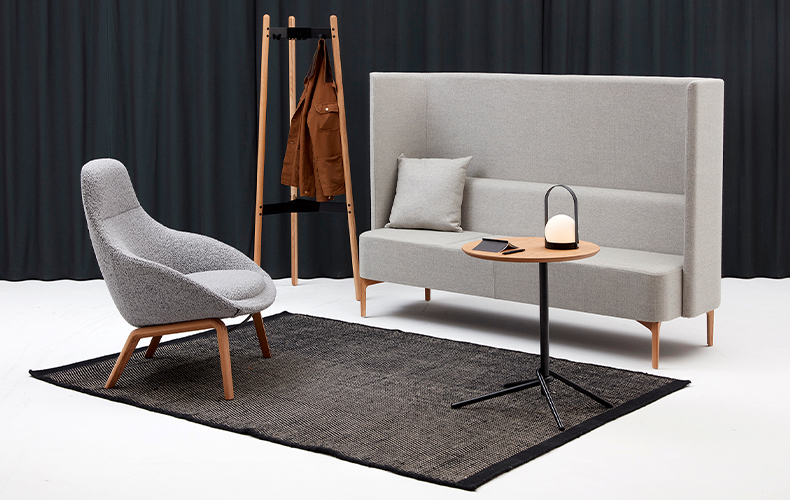 Conceptual seating area with chair and high-back sofa