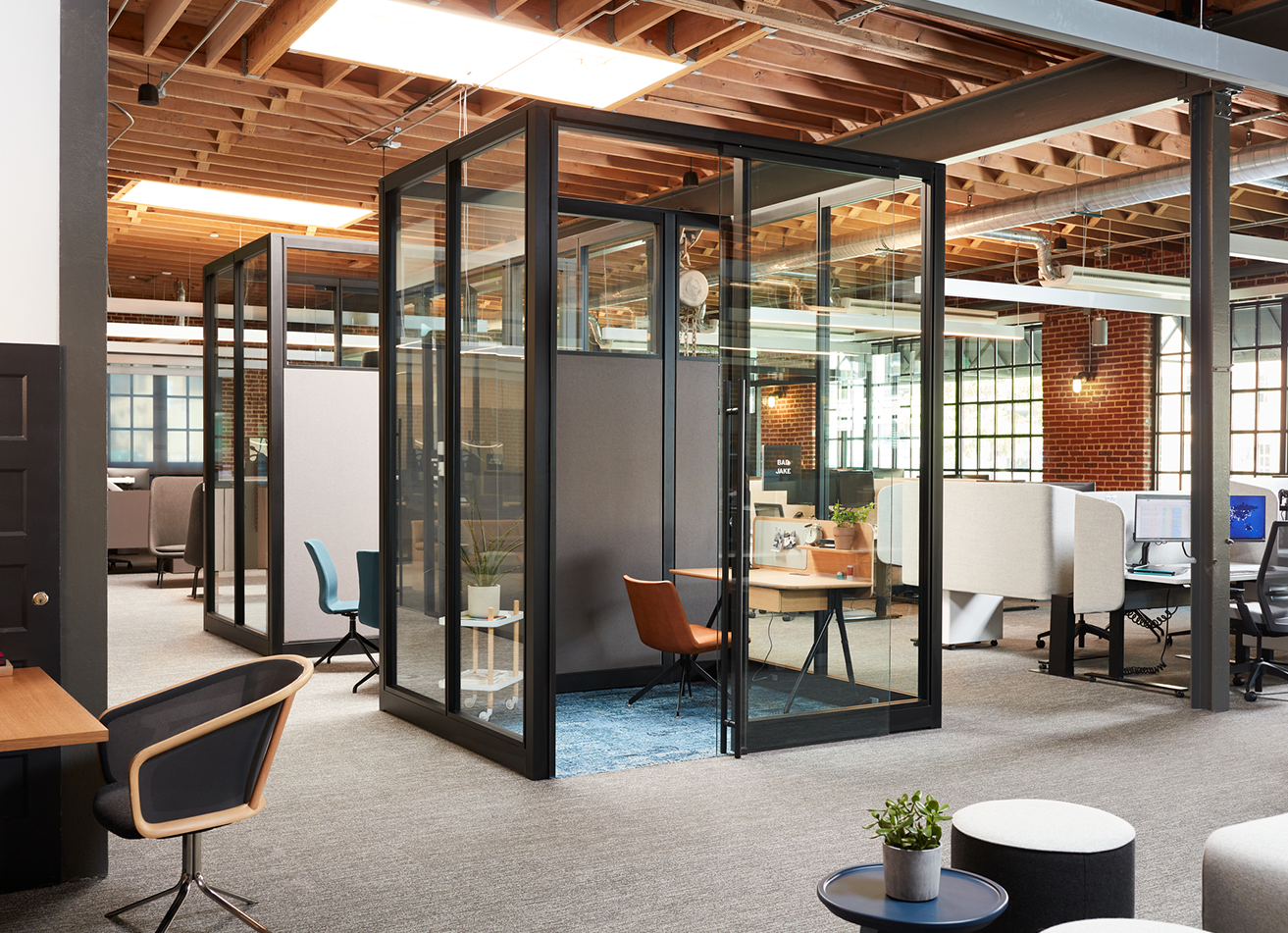 IE Showroom with glassed-in cubicles and workspaces