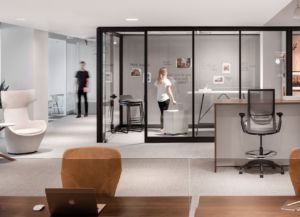 View of NeoCon office with meeting room and open concept workspaces