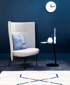 Accent chair and table with dark blue wall