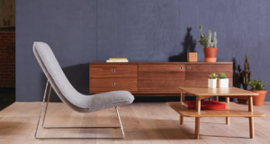 Pebble accent chair with wood credenza