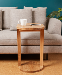 Accent wood end table against grey sofa