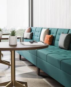 Turquoise sofa with large windows