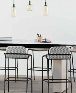 High table seating with accent chairs and lighting