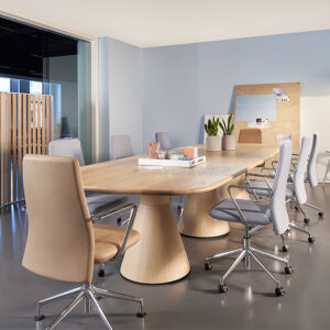 Conference room with light wood table and office chairs