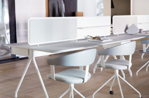 Minimal white group desks for collaboration spaces