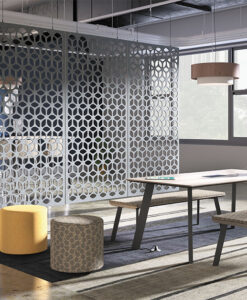 Divided meeting spaces with accent wall and stylish ottomans
