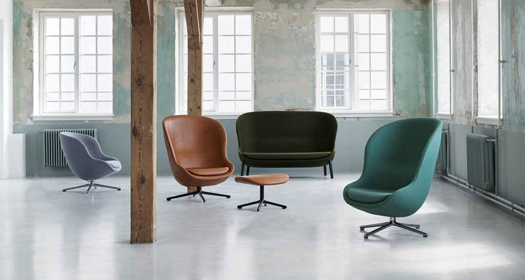 Minimal industrial lounge with accent egg-style chairs
