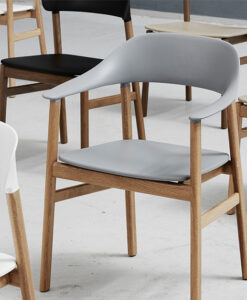 Collection of simple wood chairs with different coloured cushions