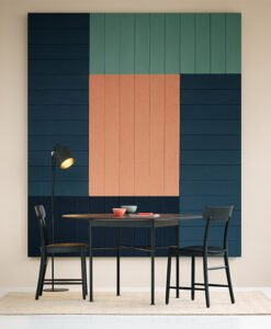 Small table in front of accent acoustic wall panels