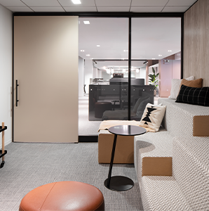 Private collaboration space with glass windows and modular seating