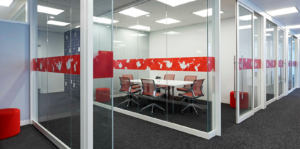 Glassed-in board room with red accents on glass