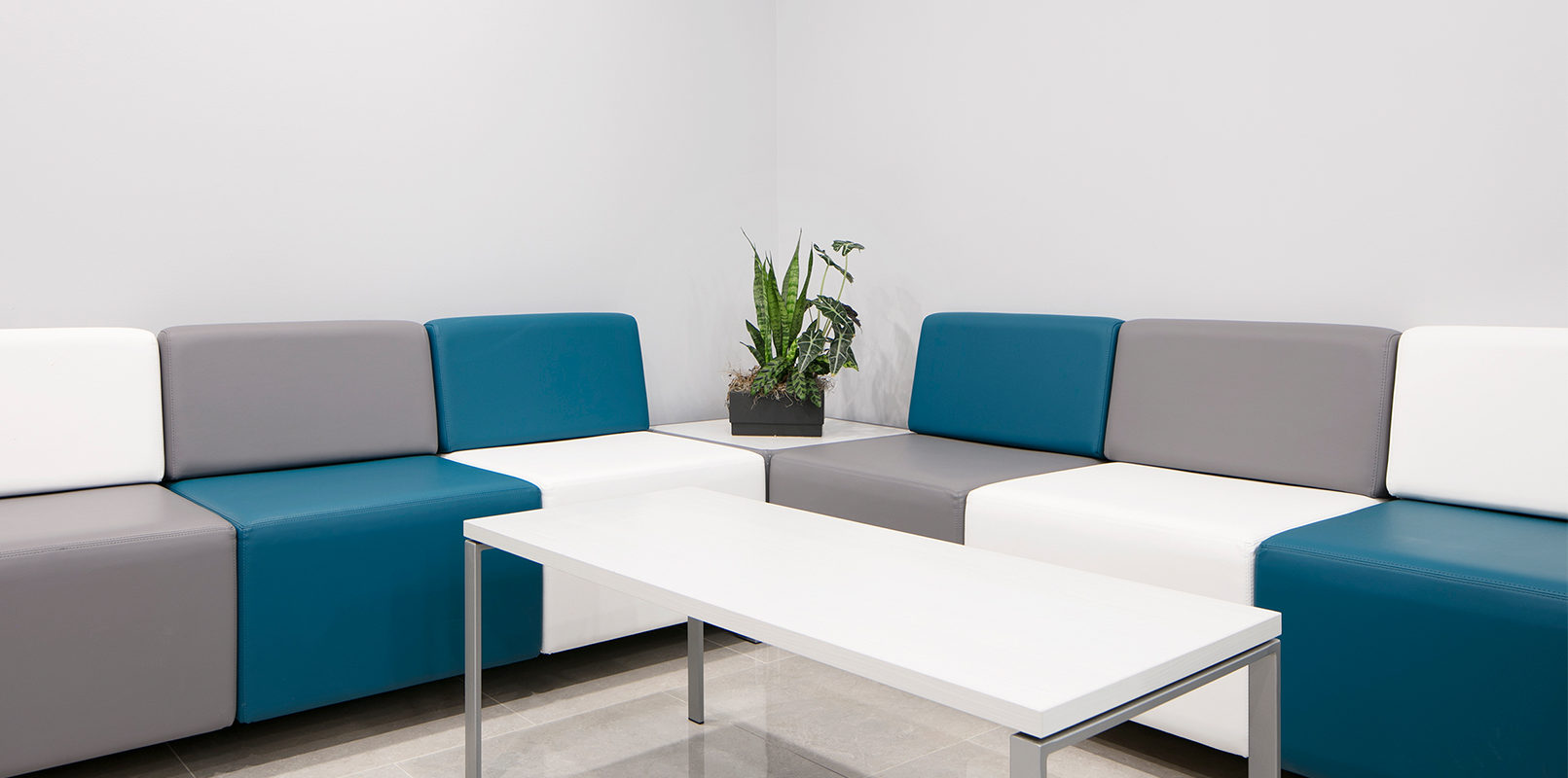 Lounge seating area with multi-coloured modular sofa chairs