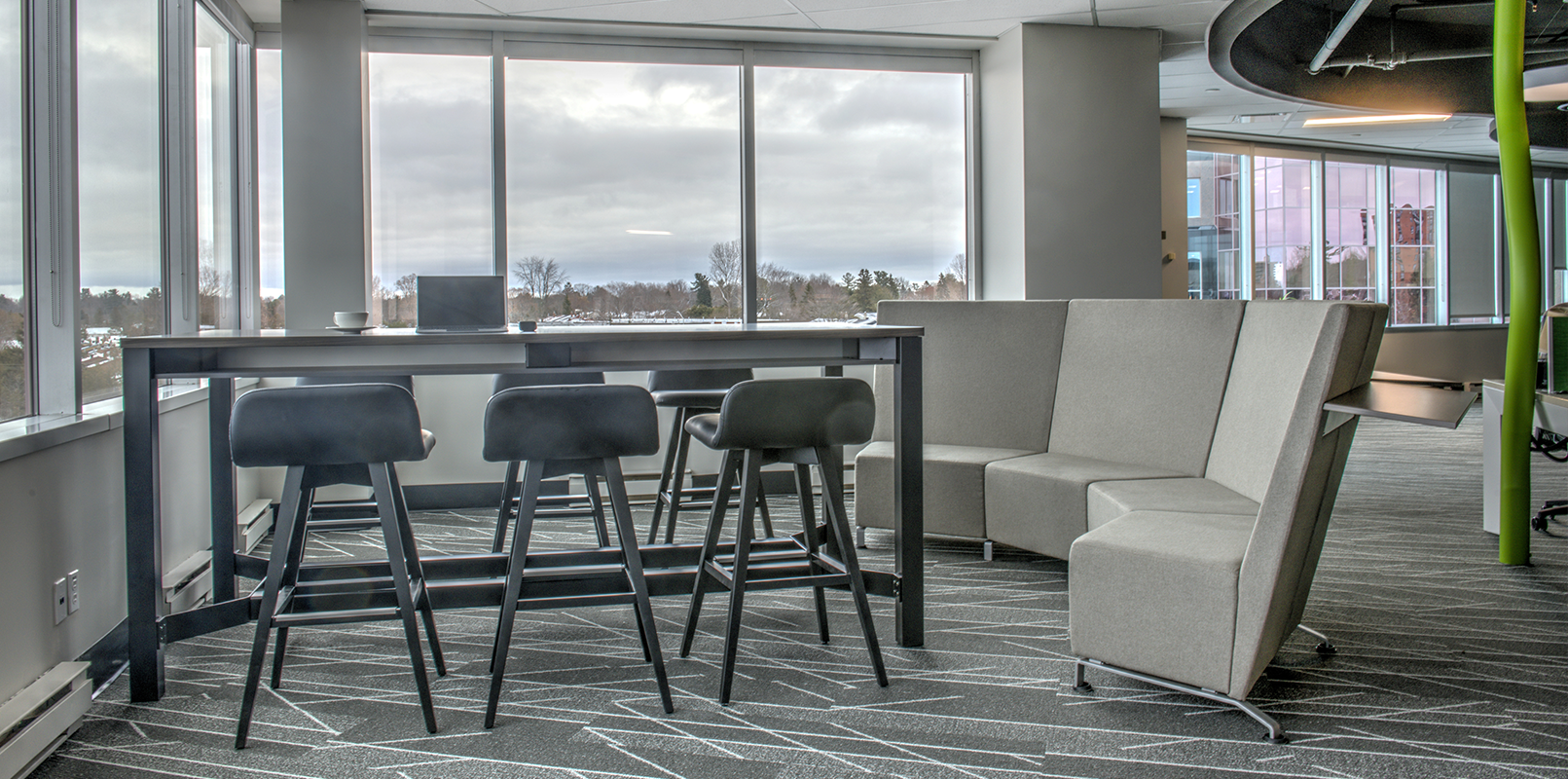 Wide view of collaboration desk and lounge sofa