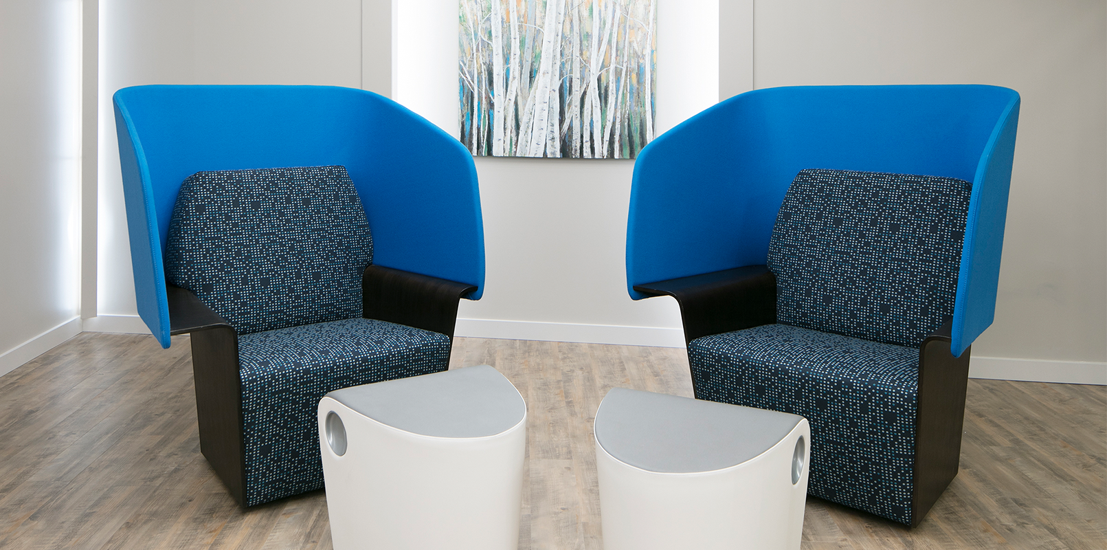 Two blue accent chairs with modern end tables